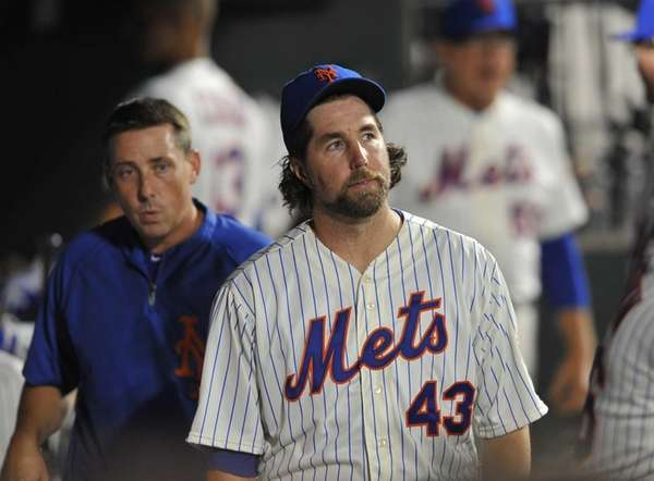 R.A. Dickey reacts after he was pinch-hit for