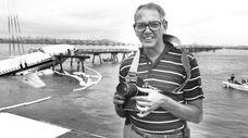 Newsday photographer Alan Raia covering the USAir Flight