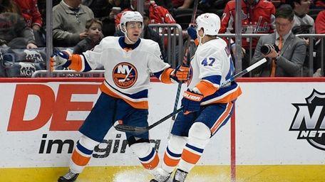 Islanders center Casey Cizikas, left, celebrates his goal