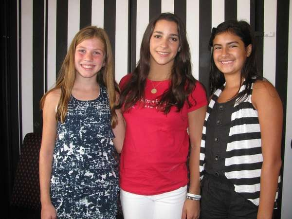 Olympic gymnast Aly Raisman (center) with Kidsday reporters