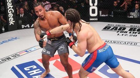 Ray Cooper III fights David Michaud in the