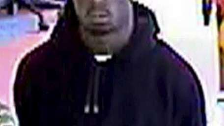 A robber wearing a Pittsburgh Penguins cap ran