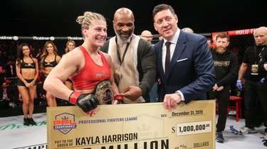 Kayla Harrison celebrates winning the PFL women's lighweight