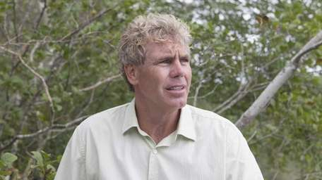Peconic Baykeeper Kevin McAllister and other environmental officials