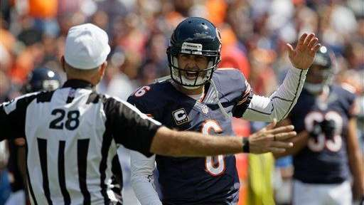 Chicago Bears quarterback Jay Cutler argues a call