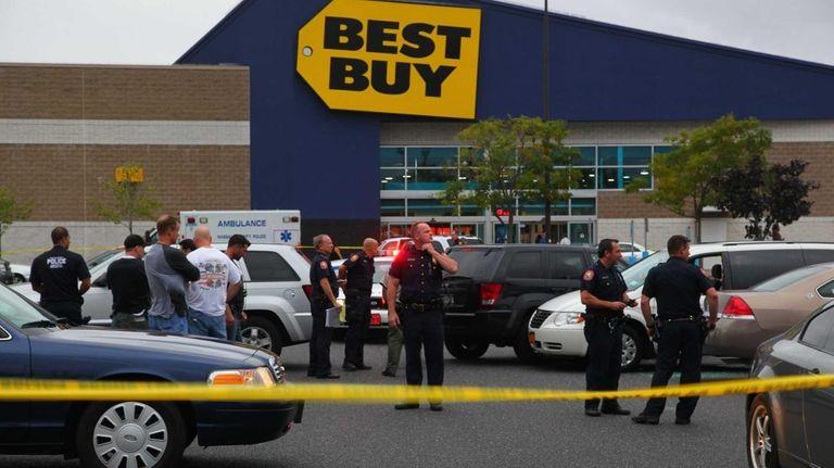 Nassau Police investigate the scene of a police