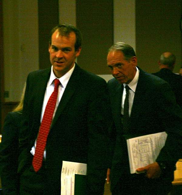 Attorney Ian Carleton walks out of court in