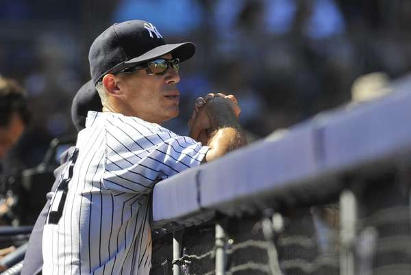 Joe Girardi observes his team from the dugout