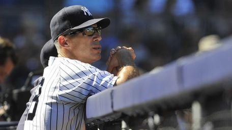Joe Girardi observes his team from the dugout