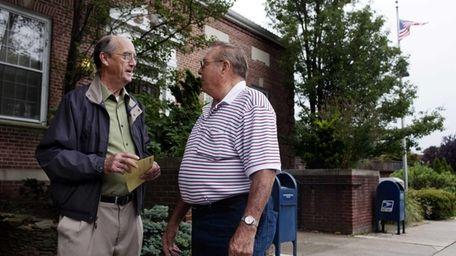 Longtime Northport residents John Brooks, left, and Robert