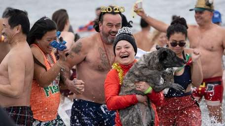 People, and a dog, plunge into the Atlantic