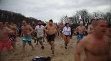 Northport residents plunged into the freezing waters Wednesday