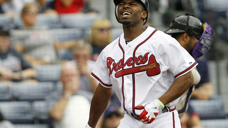 Atlanta Braves outfielder Michael Bourn reacts after striking