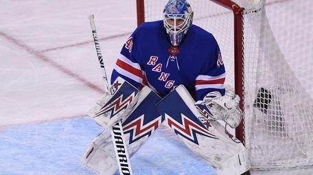 New York Rangers goaltender Alexandar Georgiev protects the