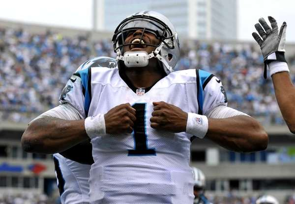 Carolina Panthers' Cam Newton reacts after running for