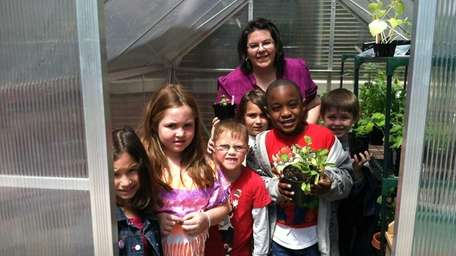 Pupils show off plants in Covert Elementary's new