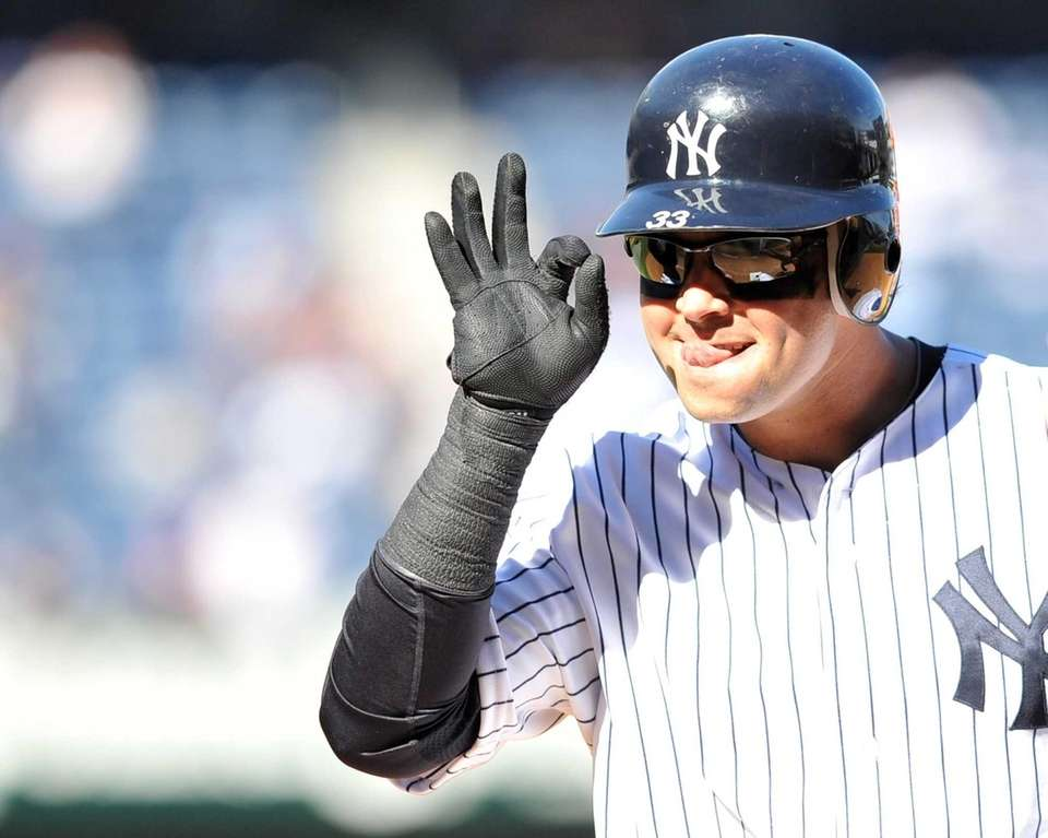 Nick Swisher reacts after connecting on an RBI