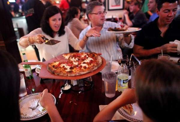 Patrons dine at Anthony's Coal Fired Pizza restaurant