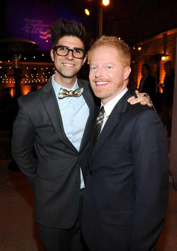 Actor Jesse Tyler Ferguson, right, of