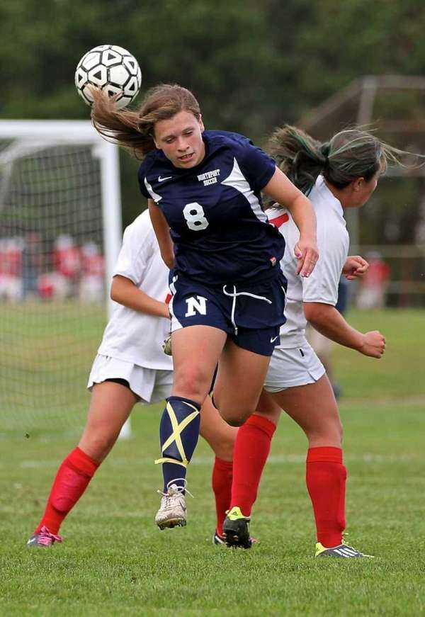 Northport defender Kristin Desmond heads the ball away