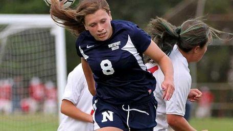 Northport defender Kristin Desmond heads the ball away