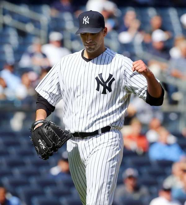 Andy Pettitte pumps his fist after a third-inning