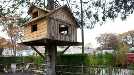 A large treehouse in a Babylon neighborhood does