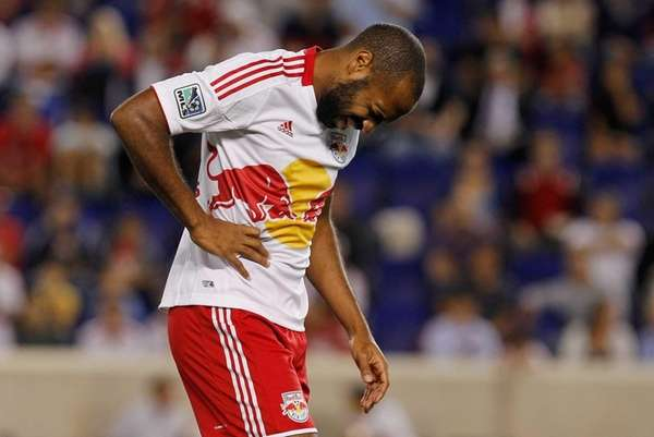 Thierry Henry reacts after being injured during the