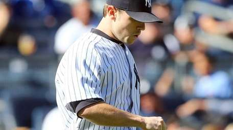 David Robertson looks on in the eighth inning