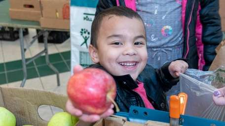 Jacob Lam, 4, of Valley Stream, shops for