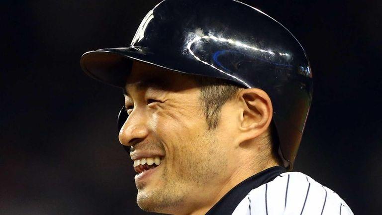 Ichiro Suzuki smiles after his eighth-inning RBI single