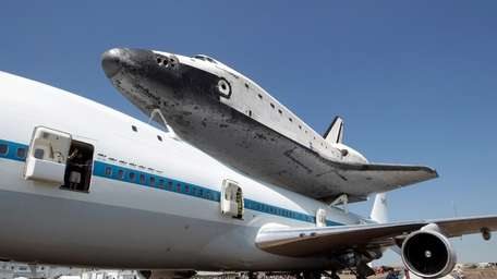 Space Shuttle Endeavour rests atop NASA's 747 transport
