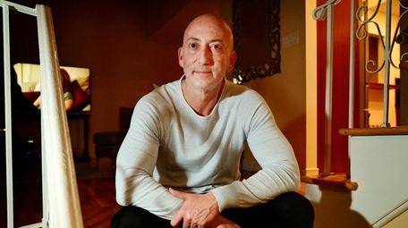 Owen Watstein in his Merrick home Thursday, after