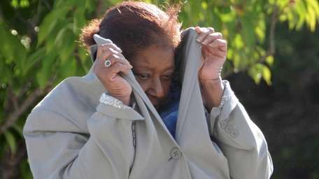 Mary Kimbrough, 64, enters Suffolk County Court is
