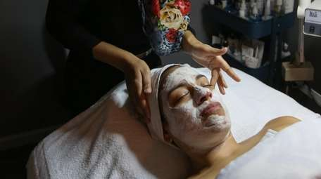 Margie Rivero, of Franklin Square, has a facial