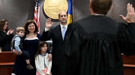 Robert Calarco (D-Patchogue) is sworn in as presiding