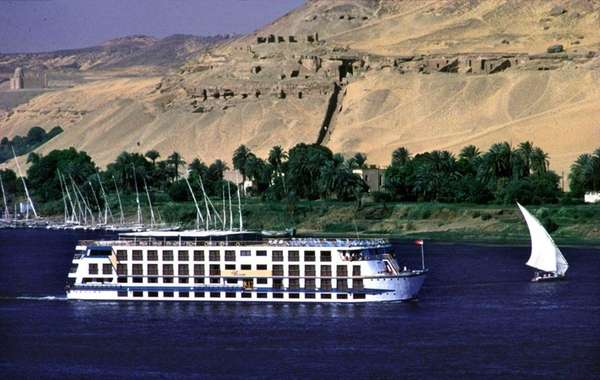 A Nile cruise boat sails between Aswan and