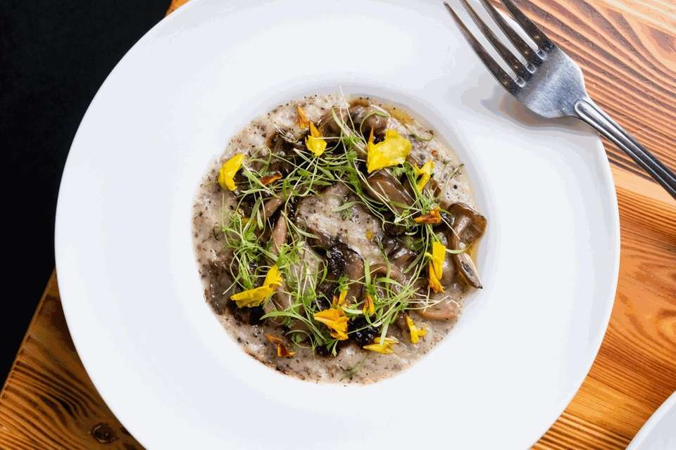 Black truffled risotto with mushrooms, black-truffle jus and