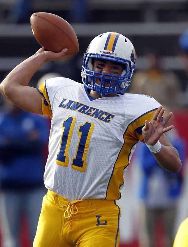Lawrence quarterback Joe Capobianco throws a short pass