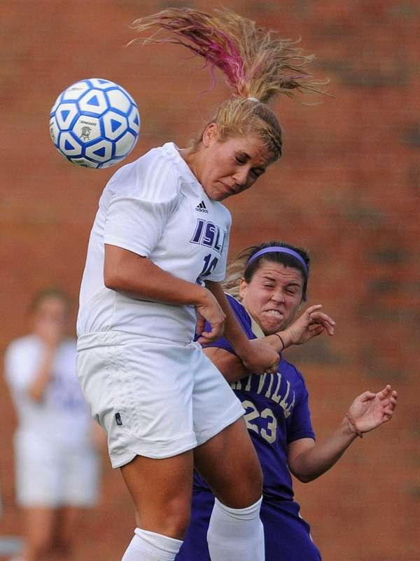 Islip's Sarah McGarry, left, heads a ball away