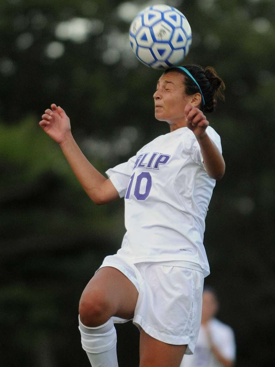Islip's Morgan Santoro heads the ball in the