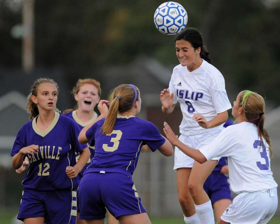 Islip's Rachel Cipriano heads the ball in the