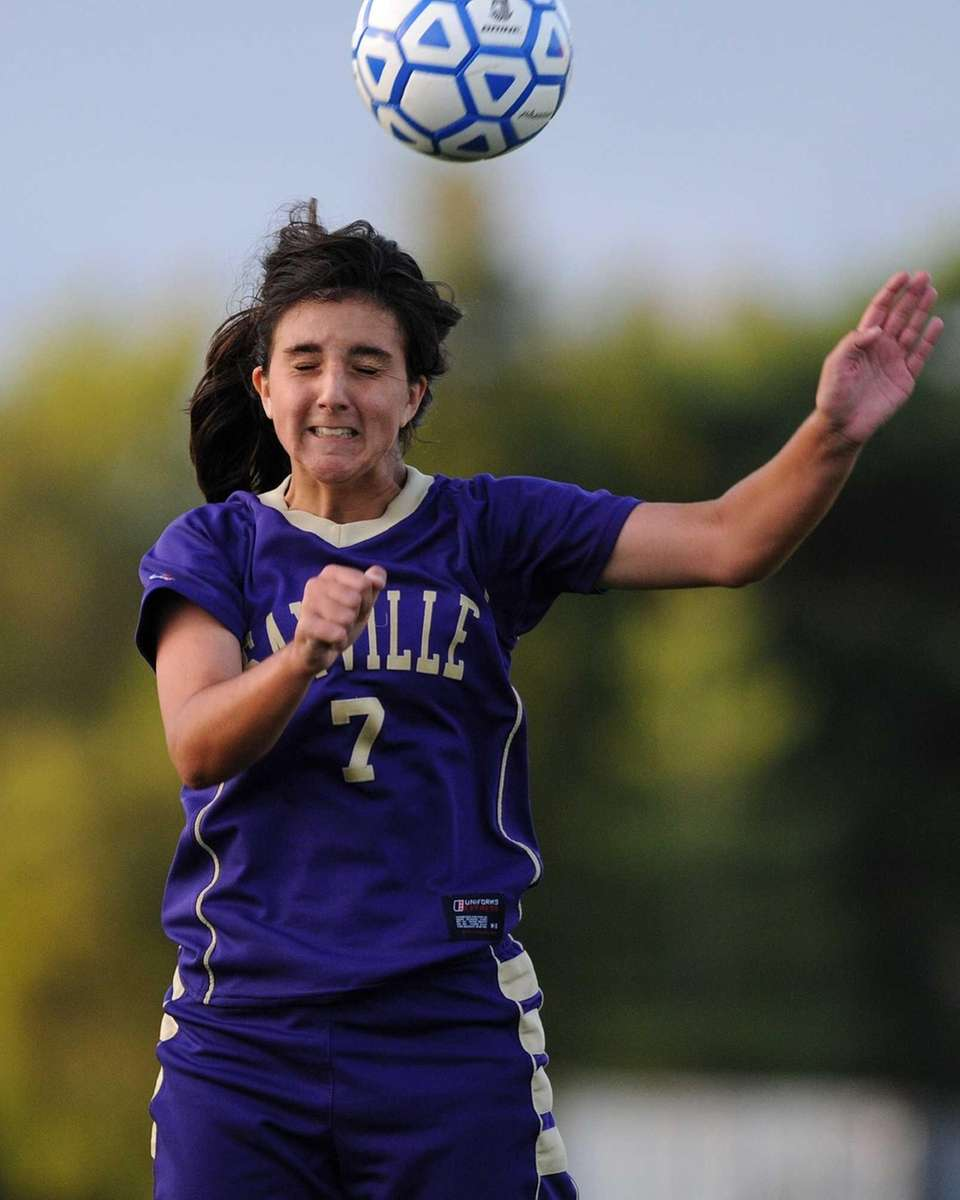 Sayville's Jessica O'Shaughnessy heads the ball during overtime