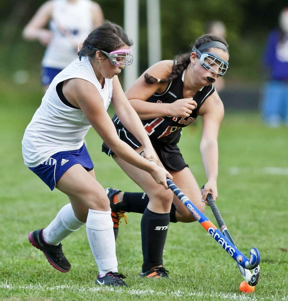Port Jefferson's Casey Gray fights for the ball