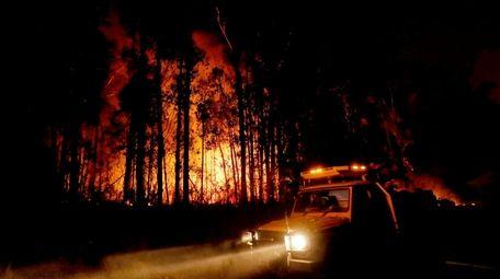 Crews monitor fires and begin back burns between
