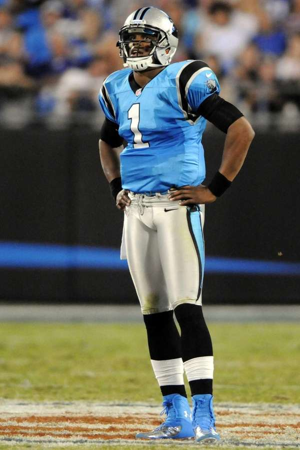 Carolina Panthers quarterback Cam Newton looks out on