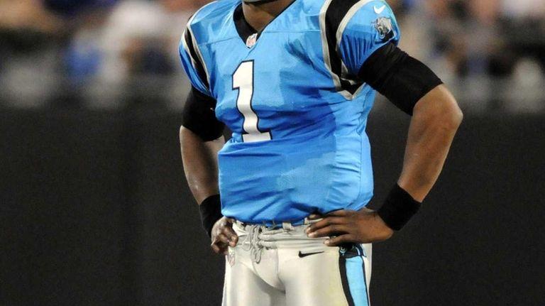 Carolina Panthers quarterback Cam Newton looks out on