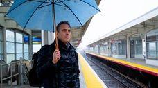 Darren Kotchek of Plainview waits for a train
