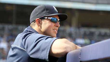 Mark Teixeira looks on from the dugout during