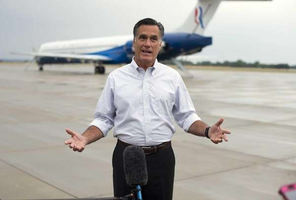 Mitt Romney holds a news conference after landing at Jetsun Aviation Center in Sergeant Bluff, Iowa. (Sept. 7, 2012)